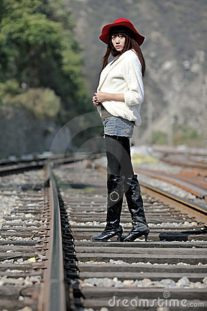 Asian model on train tracks