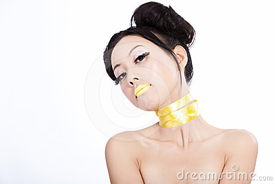 Asian model with yellow lips and creative hair