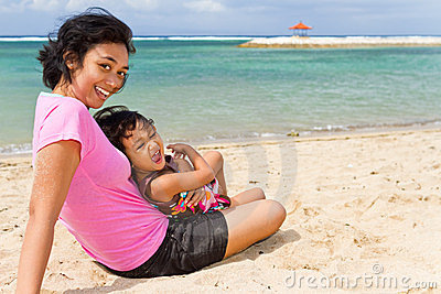 Asian mother and child happy vacation on the beach
