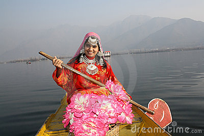 Asian Native Girl rowing a Boat