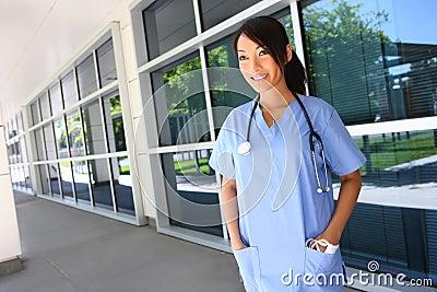 Asian nurse outside hospital