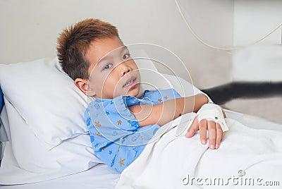 Asian patient boy with saline intravenous (iv).
