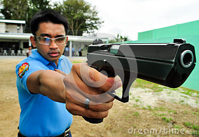 Asian police shooting practice Editorial Stock Image