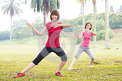 Asian practicing tai chi outdoor