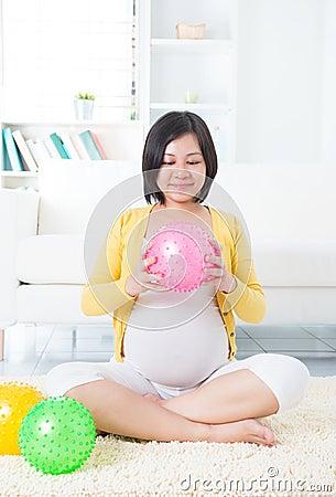 Asian pregnant woman exercising