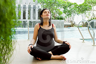 Asian pregnant woman meditate