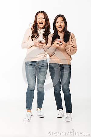 Free Asian Pretty Excited Positive Ladies Sisters Chatting Stock Image - 108185321