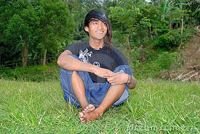 Asian punk teenager on lawn