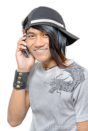 Asian punker calling by cell phone