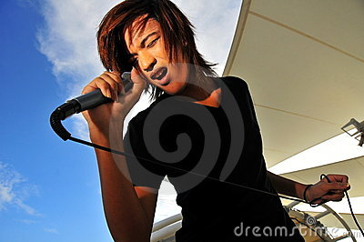Asian Rock Star with microphone singing