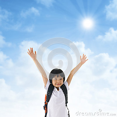 Asian school girl arms up in the air