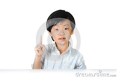 Asian schoolboy raising his index finger
