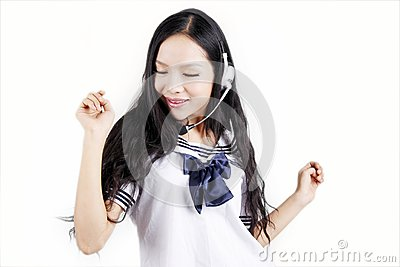 Asian schoolgirl enjoying music