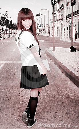 Asian schoolgirl outdoors.