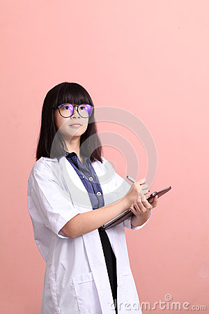 Asian scientist taking note on tablet Stock Photo