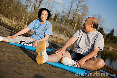 Asian senior couple exercise