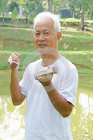Asian senior man healthy lifestyle working out on a park