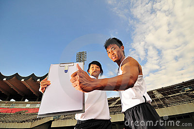 Asian Sports Duo and Blank Clipboard