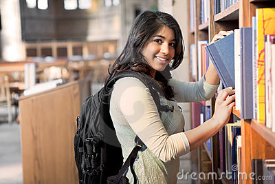 Asian student in library
