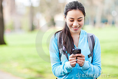Asian Student Texting On The Phone Stock Photo - Image: 19623220
