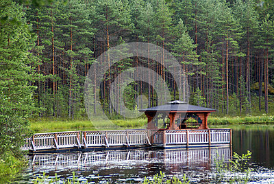 Asian style pagoda on a lake in European forest