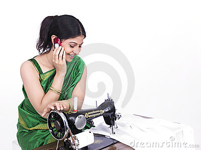 Asian tailor her cell phone