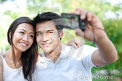 Asian Taking photos