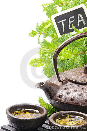 Asian teapot with green tea