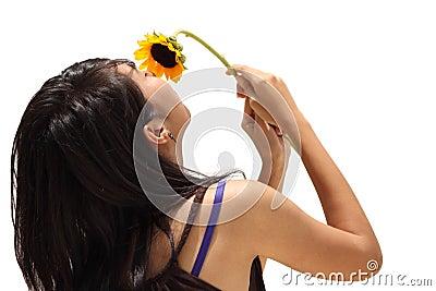 Asian teen girl smell flower