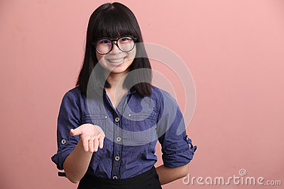 Asian teen palm up Stock Photo