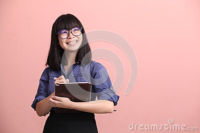 Asian teen writing tablet Stock Photo