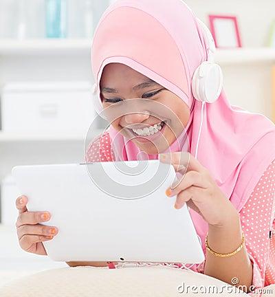 Asian teenager listen mp3 headphone