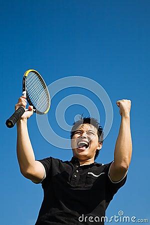 Asian tennis player joy of winning