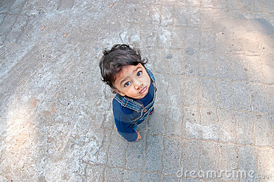 Asian toddler looking up