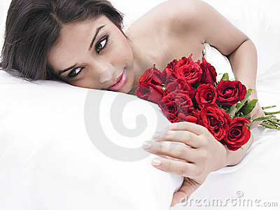 Asian virgin in bed with red roses