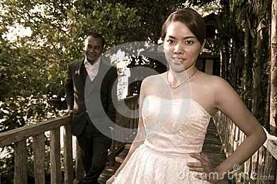 Asian wedding couple in tropical location