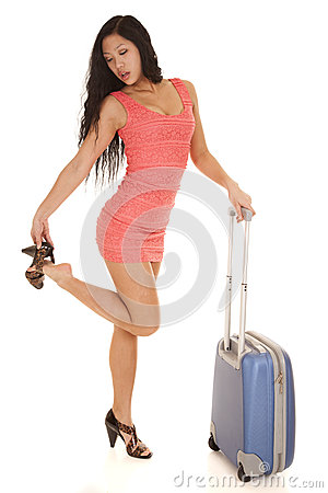 Asian woma suitcase take off shoe