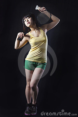 Asian woman with badminton racket