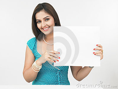 Asian woman with a blank placard