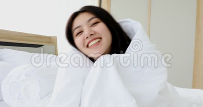 Asian woman in blanket, she laughing and smiling. Good looking Asian woman in blankets, she laughing and smiling for the camera.n stock video