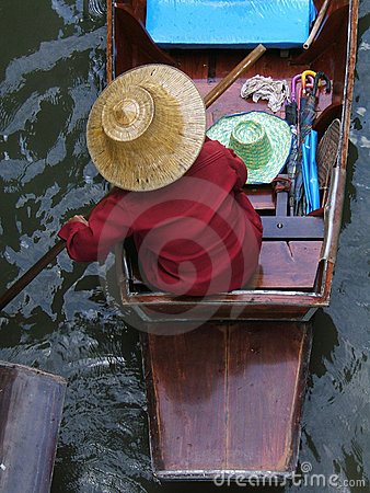 Asian woman in a boat