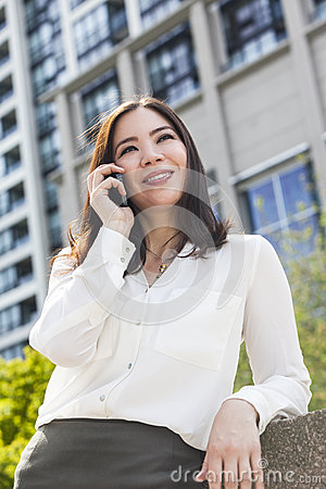 Asian Woman or Businesswoman Talking on Cell Phone