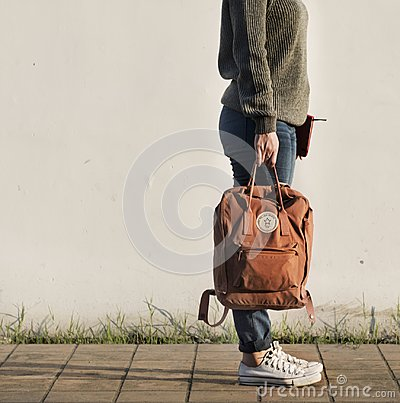 Free Asian Woman Carrying A Bag Royalty Free Stock Photography - 101851637