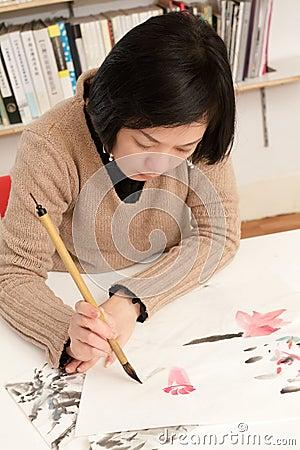 Asian woman drawing