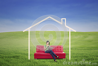 Asian woman drink coffee in dream house outdoor