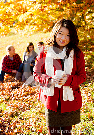 Free Asian Woman Drinking A Warm Drink Stock Images - 27668374