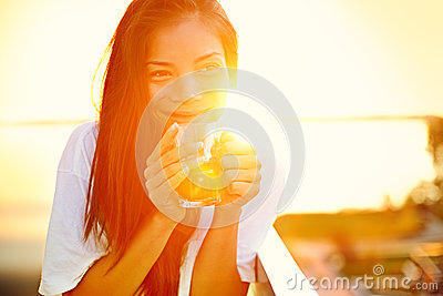 Asian woman drinking coffee in sun
