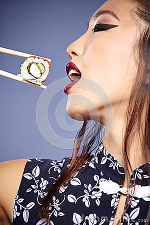 Free Asian Woman Eating Sushi, Royalty Free Stock Images - 36501419