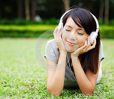 Asian woman enjoy music