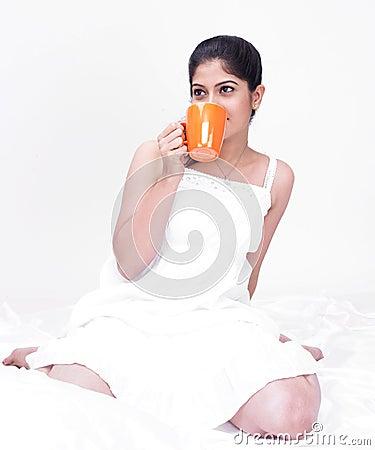 Asian woman enjoying her drink